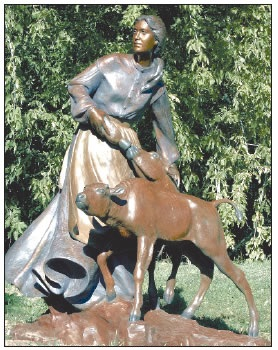 SCULPTURE OF PIONEER WOMAN FEEDING A BISON CALF