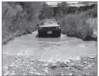 CAR DRIVING THROUGH SALT CREEK