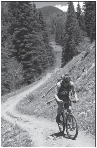 BIKER ON THE HERMOSA CREEK TRAIL