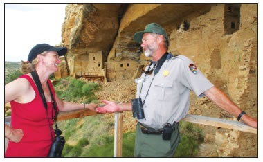 MARGI PUHLS AND INTERPRETIVE RANGER TOM WOLF NEAR CLIFF DWELLINGS AT MESA VERDE NATIONAL PARK