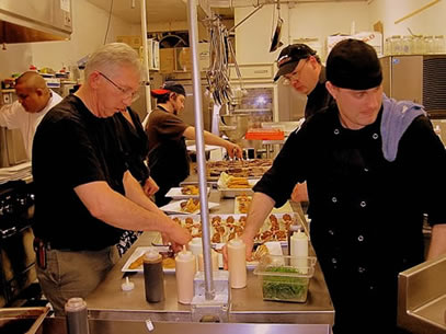 CHEFS WORKING IN THE KITCGEN AT MONTEZUMA'S TABLE