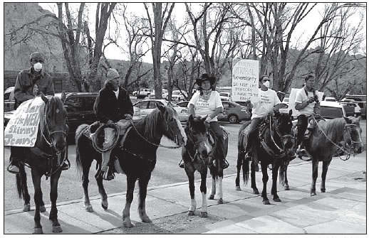 NAVAJO PROTESTERS ON HORSEBACK IN WINDOW ROCK, ARIZONA