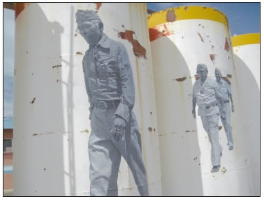WHEAT PASTED IMAGES OF NAVAJO CODE-TALKERS ON LARGE TANKS