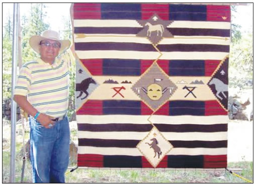 "ROY KADY DISPLAYING HIS WEAVING, ""THE SUN'S HORSES"""