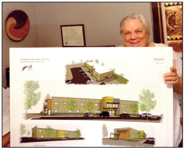 BRIDGTE SHELTER DIRECTOR LAURIE KNUTSON SHOW PLANS FOR THE NEW BUILDING.
