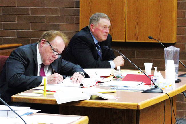 Kelly Laws (right) and his attorney, Peter Stirba, listen to testimony at the hearing in Monticello on Jan. 22. Laws, who lost to Willie Grayeyes in the November election, had challenged Grayeyes' Utah residency.