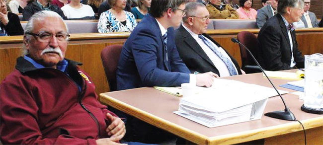 Willie Grayeyes, in red jacket in the foreground, at a Jan. 22 hearing to resolve the question of his residency.