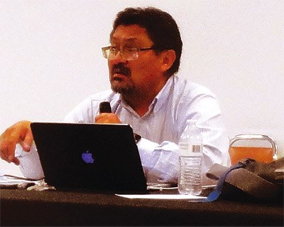 Leonard Gorman, director of the Navajo Nation Human Rights Commission, listens to testimony during a hearing on race relations in the public schools. The Cortez meeting was one of nine held in border towns around the perimeter of the Navajo Nation in March. Photo by Sonja Horoshko.