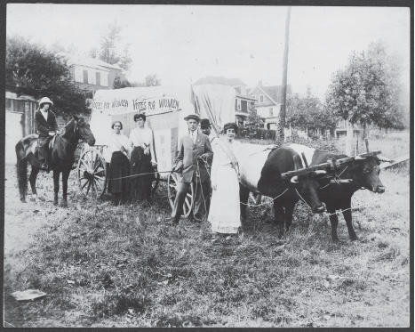 SUFFRAGETTES WITH WAGON