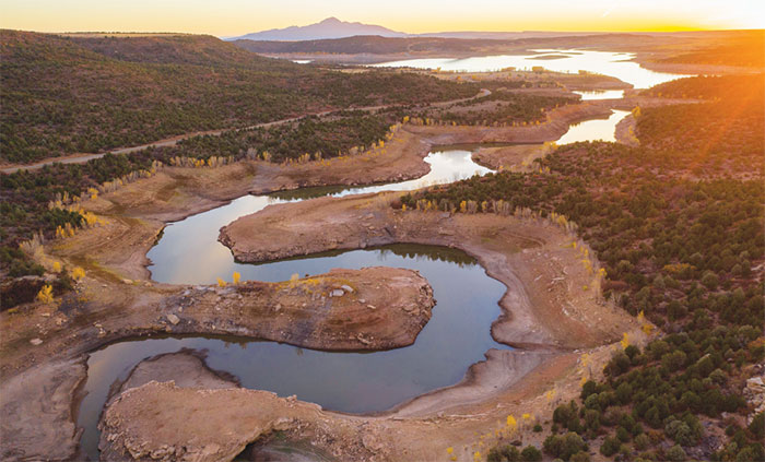 This view of McPhee Reservoir, taken looking west from House Creek on Oct. 19, shows the severity of the drought this year. Photo by Bill Hatcher