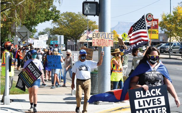 Participants in the peace march walk on Cortez's Main Street on Oct. 3.
